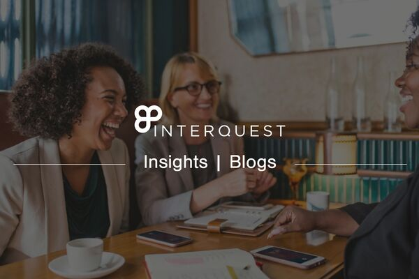 InterQuest insights blogs banner background image of three people talking at a table with cups of coffee